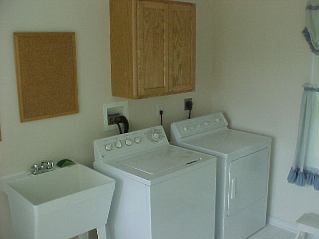 First floor laundry room off the garage.