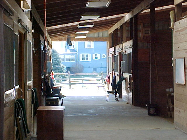 "stalls in ""upper"" barn ..attached to indoor arena"
